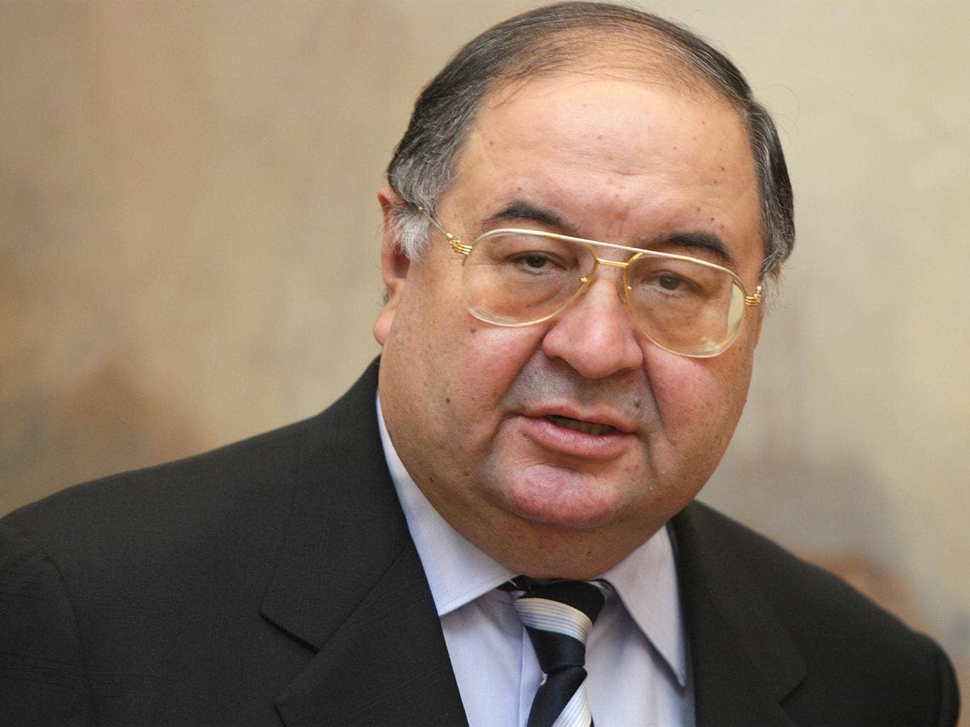 Alisher Usmanov holds almost 56 per cent of MegaFon and has a 29 per cent stake in Arsenal Football Club