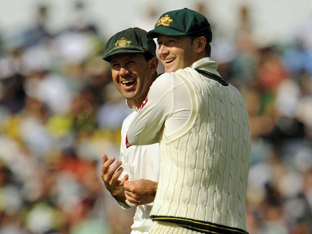 Australian Test cricket captain Michael Clarke (R) shares a joke with teammate Ricky Ponting