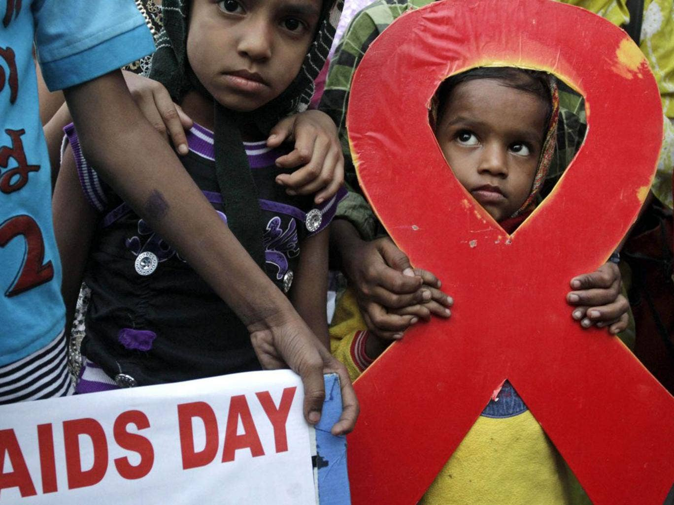 A torch light rally is held in Kolkata yesterday ahead of World Aids Day
