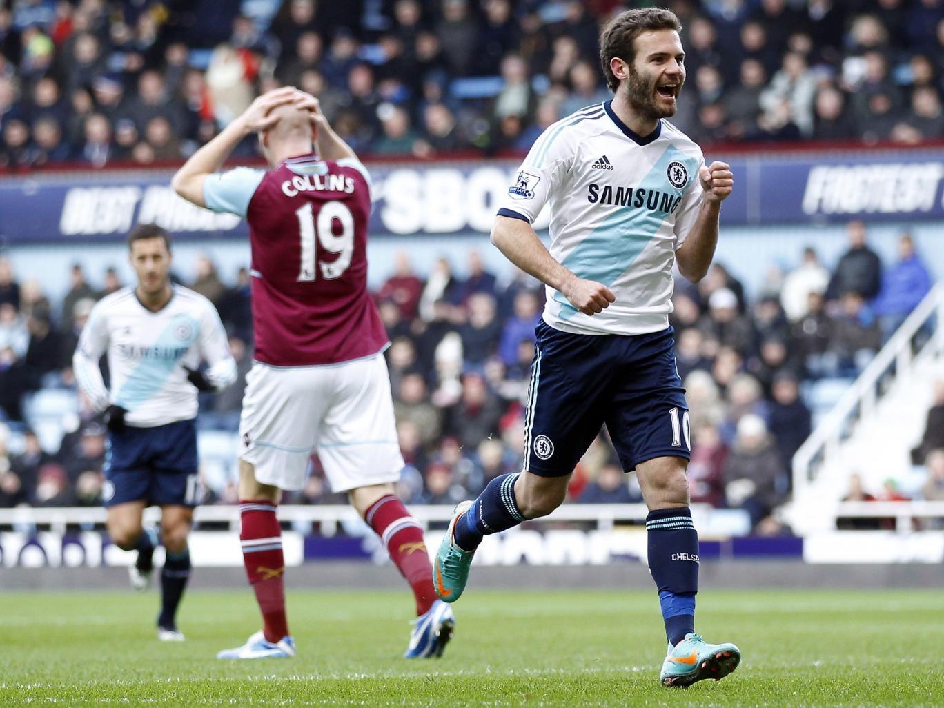 Juan Mata of Chelsea celebrates his goal, much to James Collins of West Ham's despair