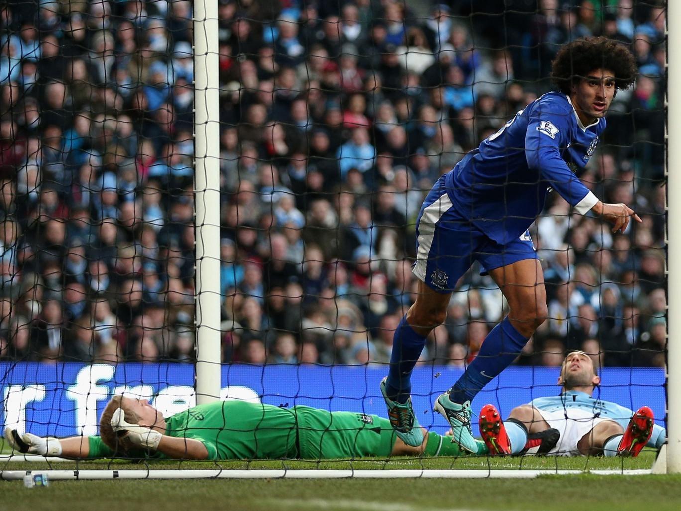 Maraoune Fellaini celebrates after scoring his goal against Manchester City