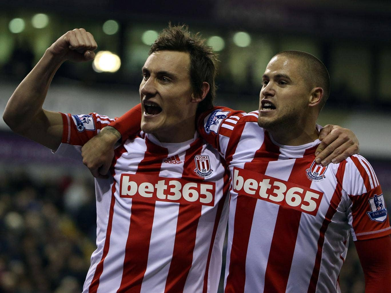 Dean Whitehead and Michael Kightly celebrate Stoke's goal