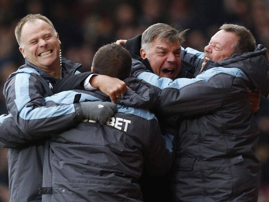 Sam Allardyce (second right) celebrates West Ham's third goal
