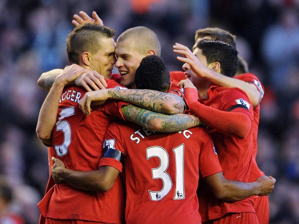 Daniel Agger (left) is congratulated for scoring Liverpool's winner