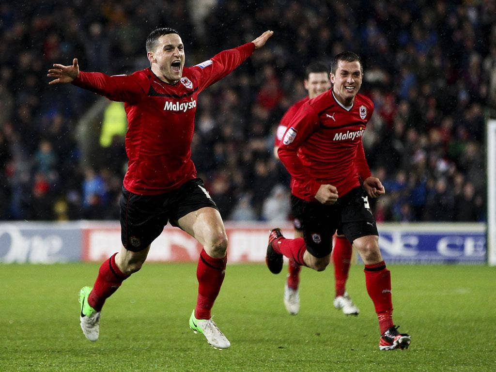 Craig Conway (left), of Cardiff, celebrates after scoring the winner