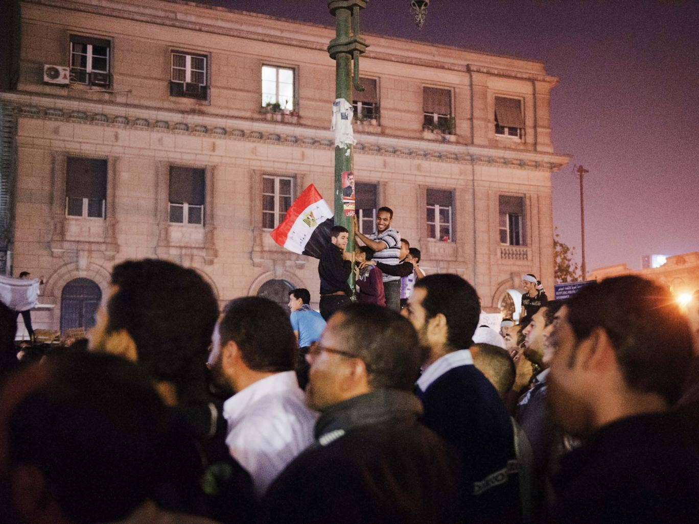 Supporters of Egypt's President Mohamed Morsi wave their national flag as they celebrate in front of the Egyptian high court in Cairo