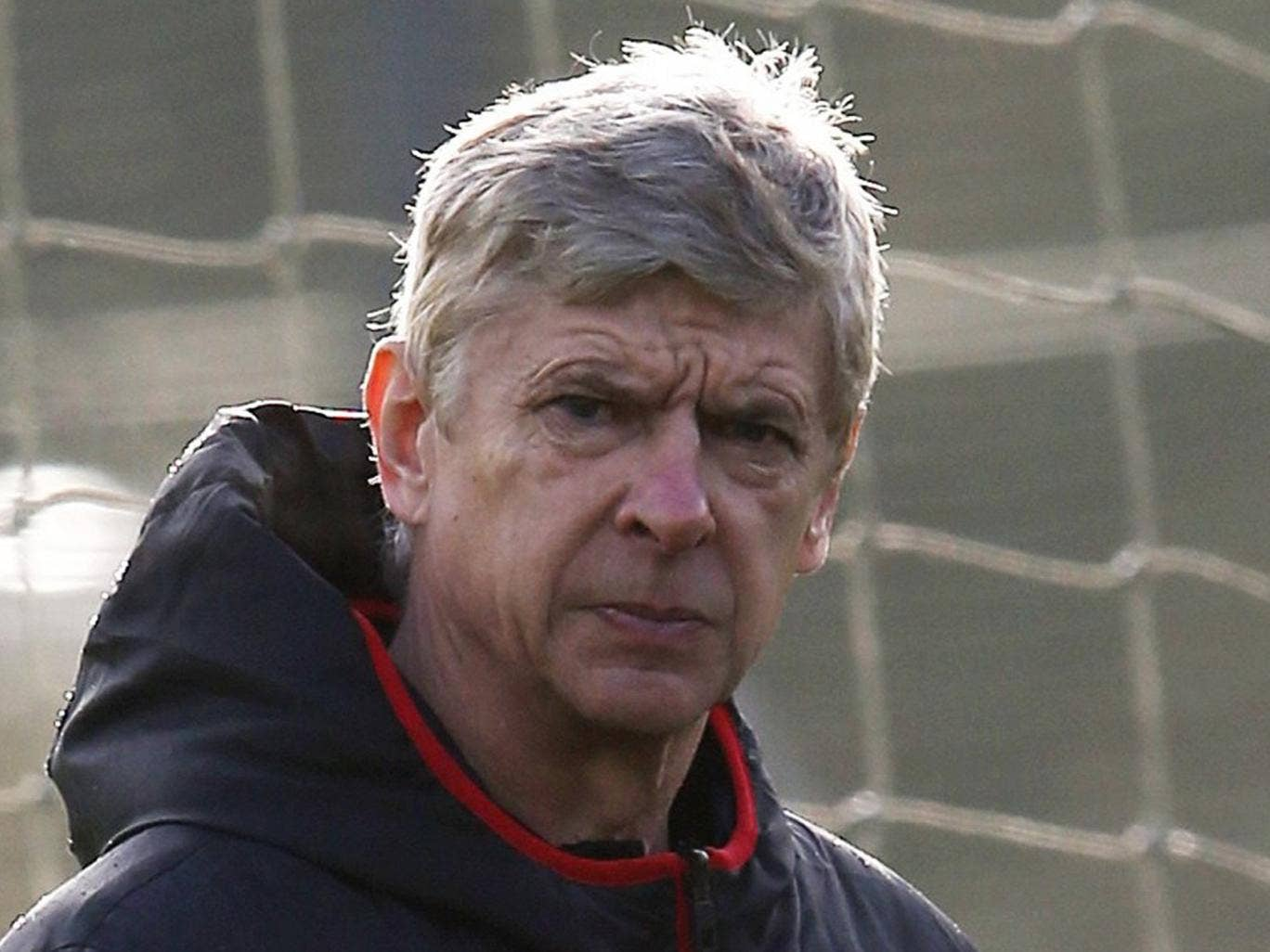 Arsène Wenger takes training at London Colney yesterday