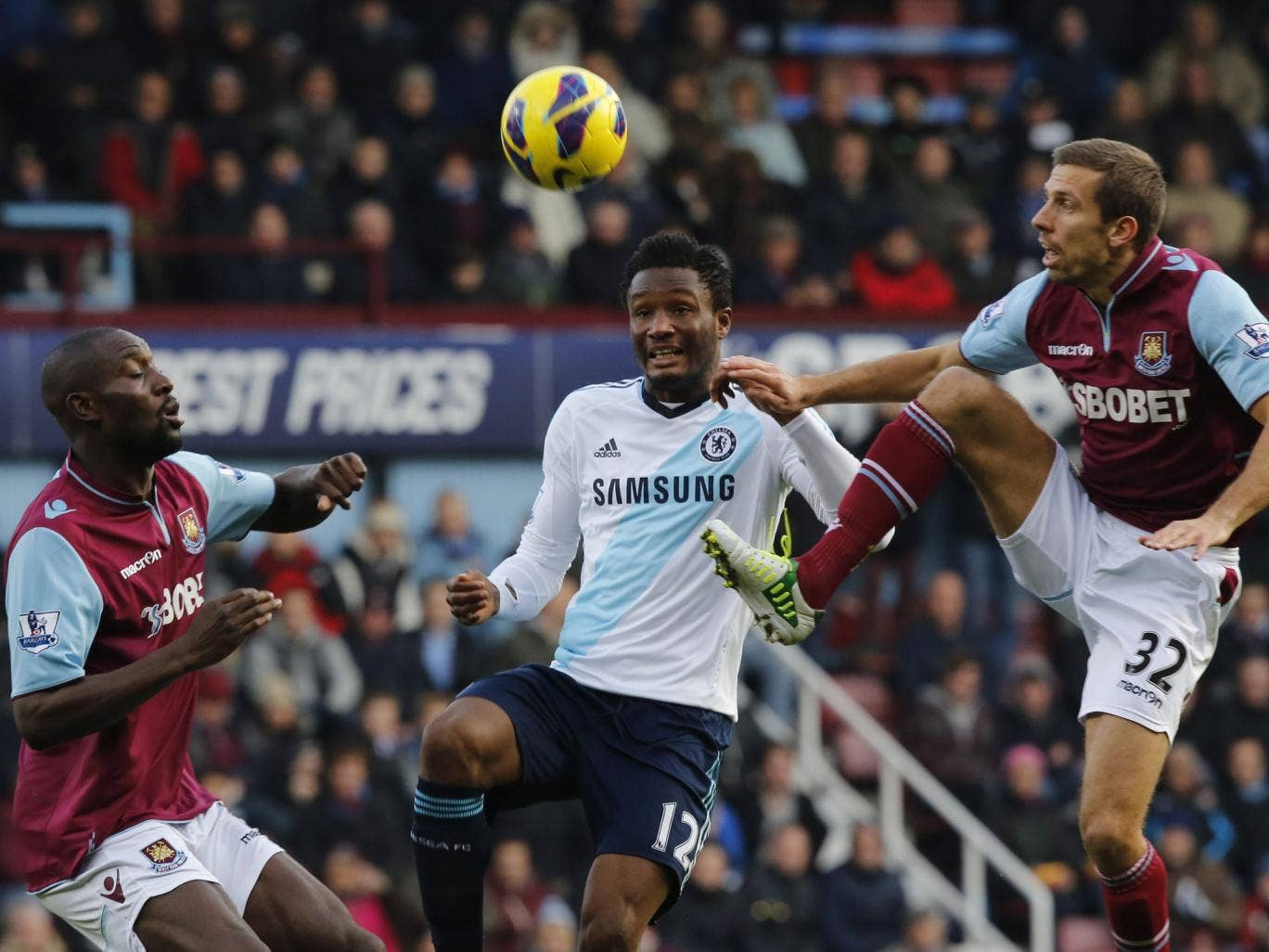 John Obi Mikel of Chelsea (C) vies for the ball with Gary O'Neil (R) and Carlton Cole (L) of West Ham United