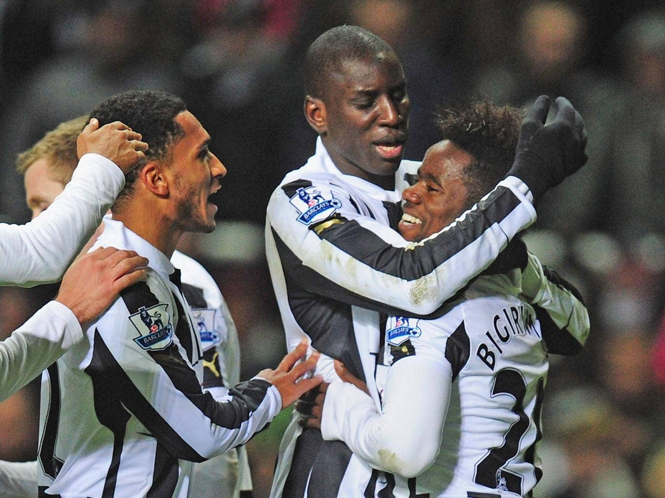 Newcastle scorer Gael Bigirimana (r) is congratulated by Demba Ba after the third goal against Wigan