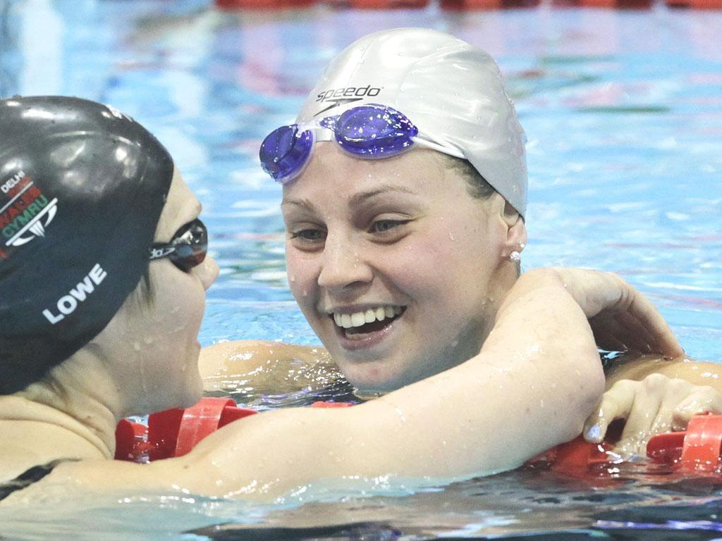 Ellen Gandy after winning gold in the women's 200m butterfly is congratulated by Jemma Lowe (left)