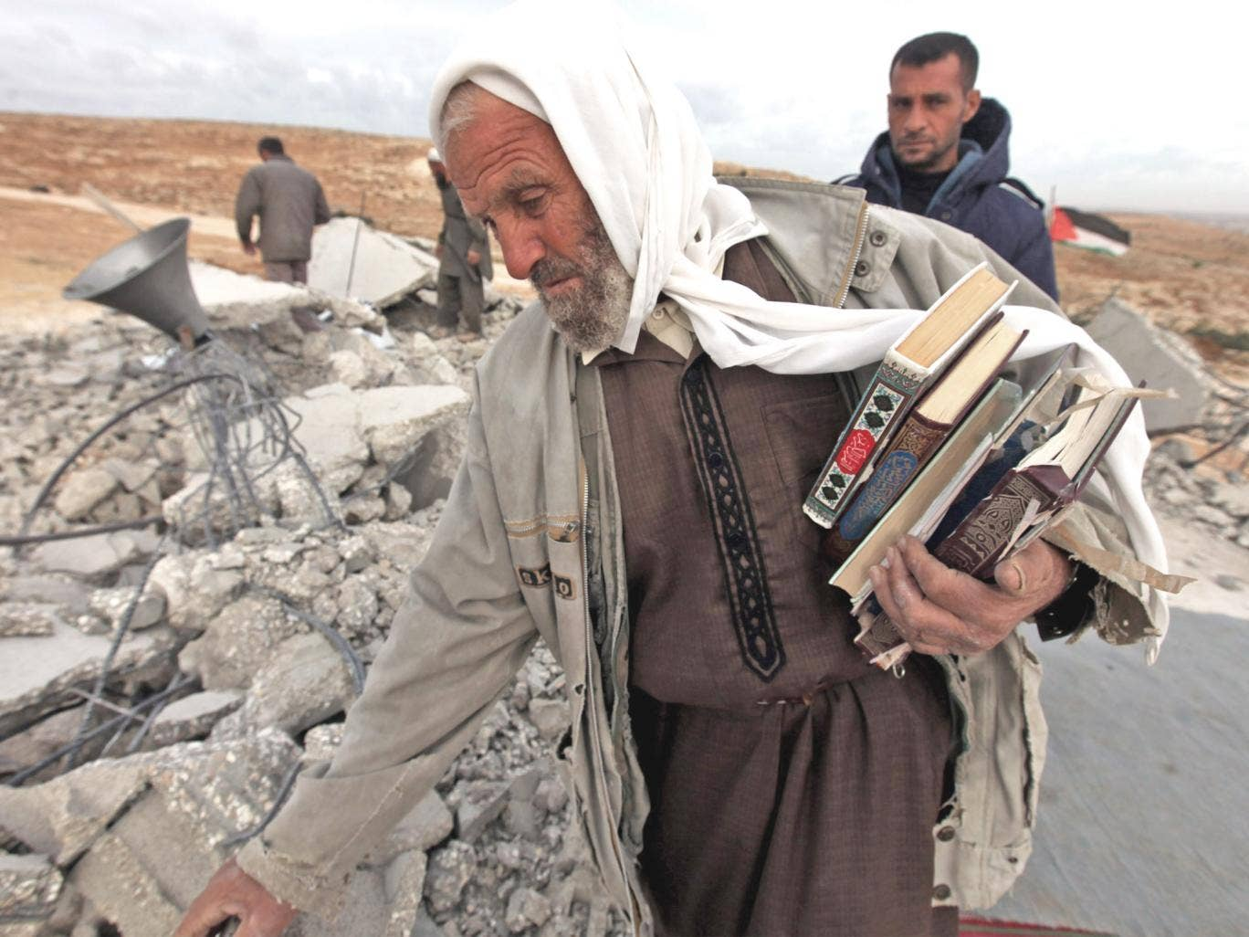 Palestinians at the rubble of a mosque near Hebron after it was destroyed by the Israeli army