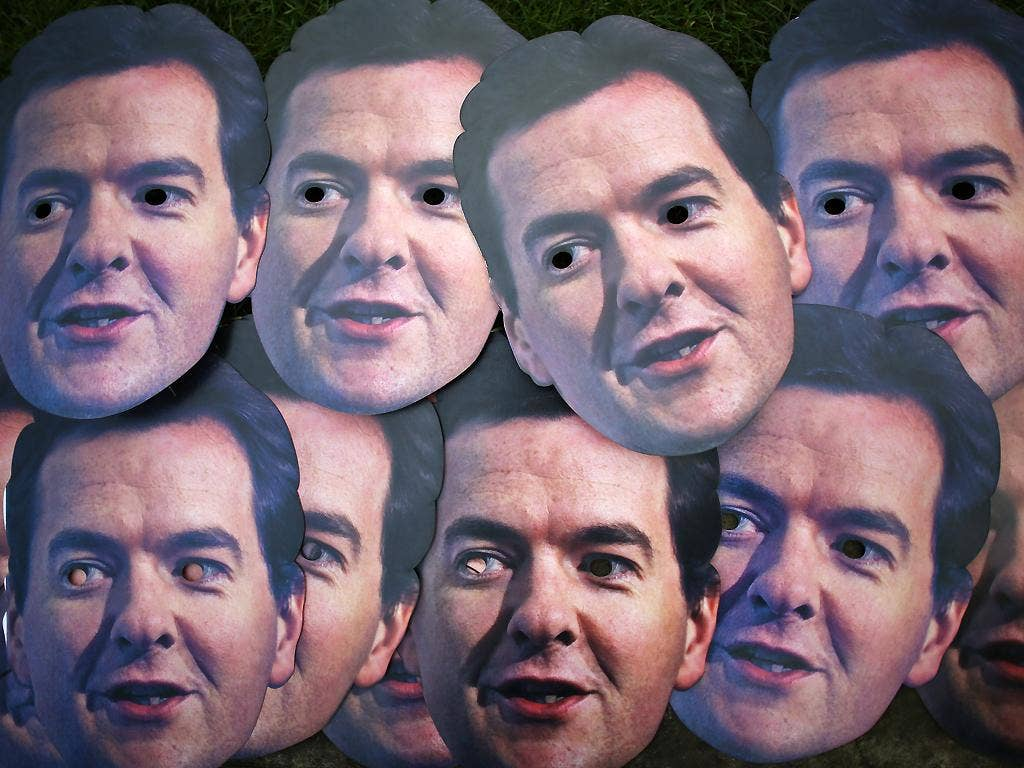 Masks depicting Chancellor George Osborne lie waiting to be used by members of the UNISON union near Parliament