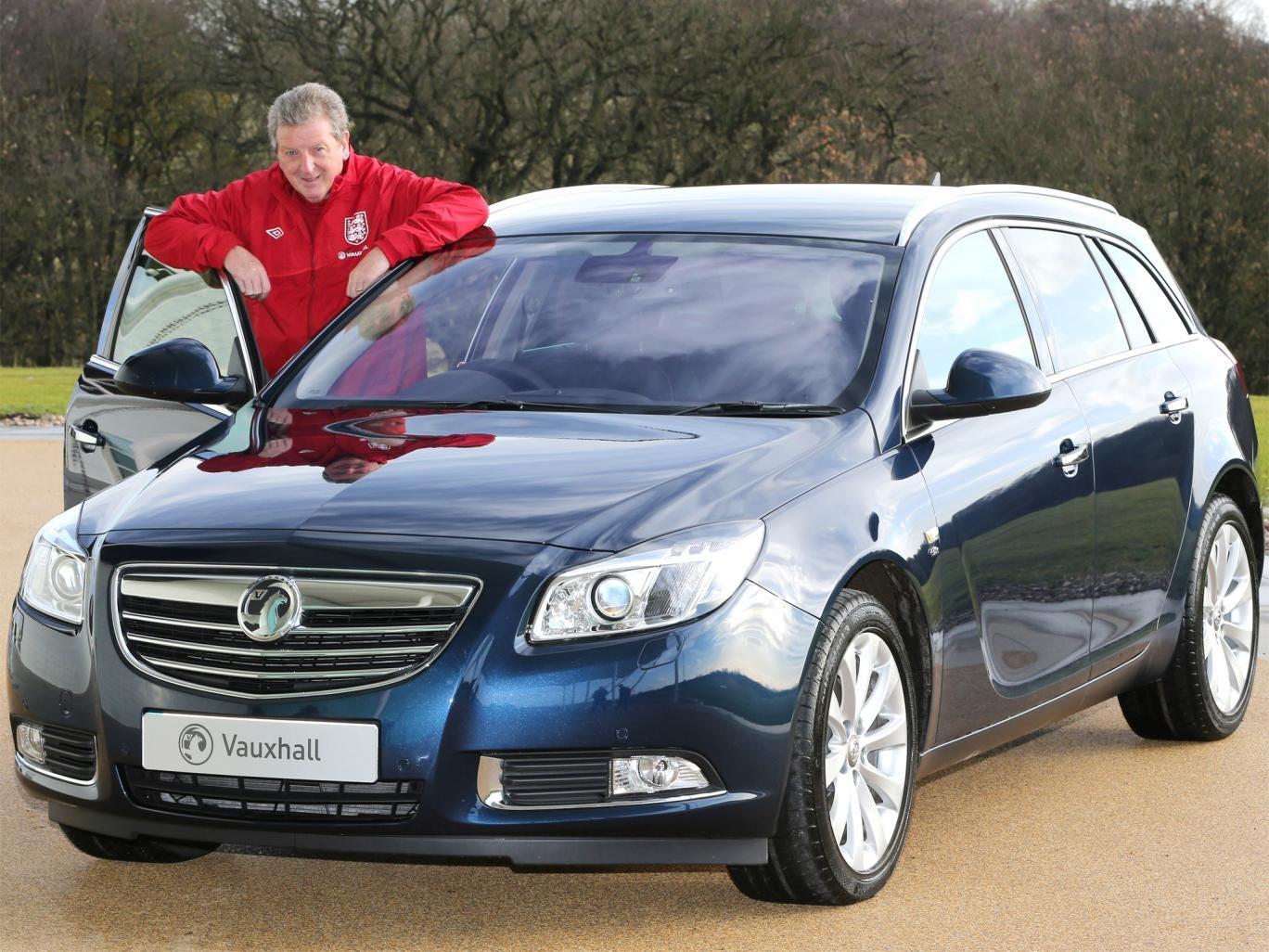 Sensible choice: Roy Hodgson and his shiny new Vauxhall Insignia
