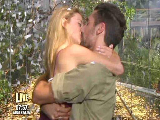 Hugo Taylor smooches girlfriend Nat Joel upon leaving the jungle