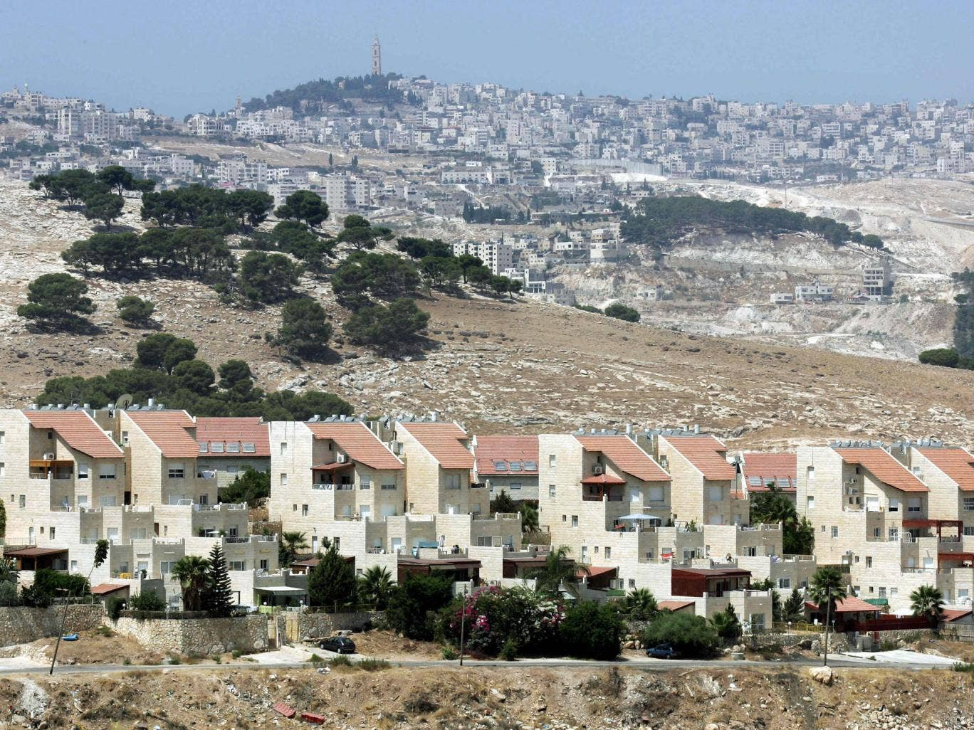 Houses (foreground) of the West Bank settlement of Maale Adumim