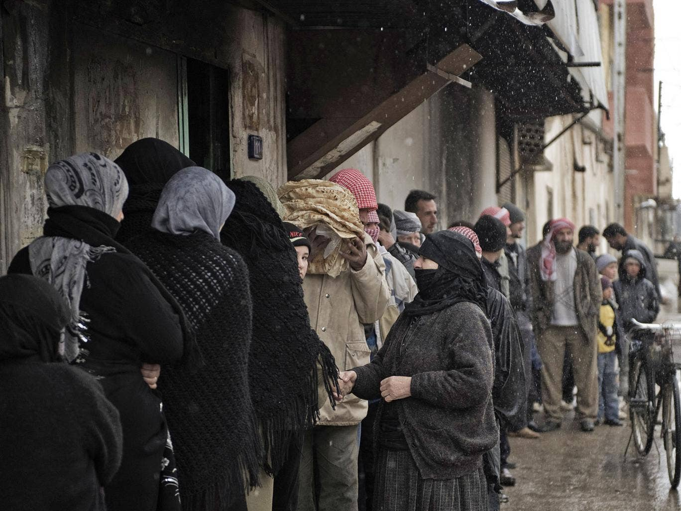 Syrians queue for bread