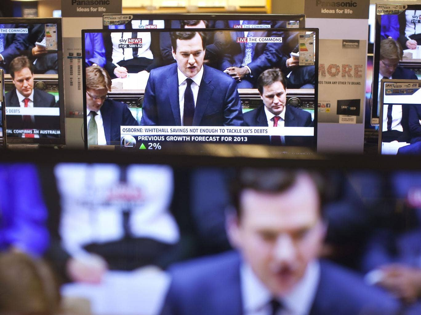 Double vision: Television screens relaying the Chancellor's Autumn Statement