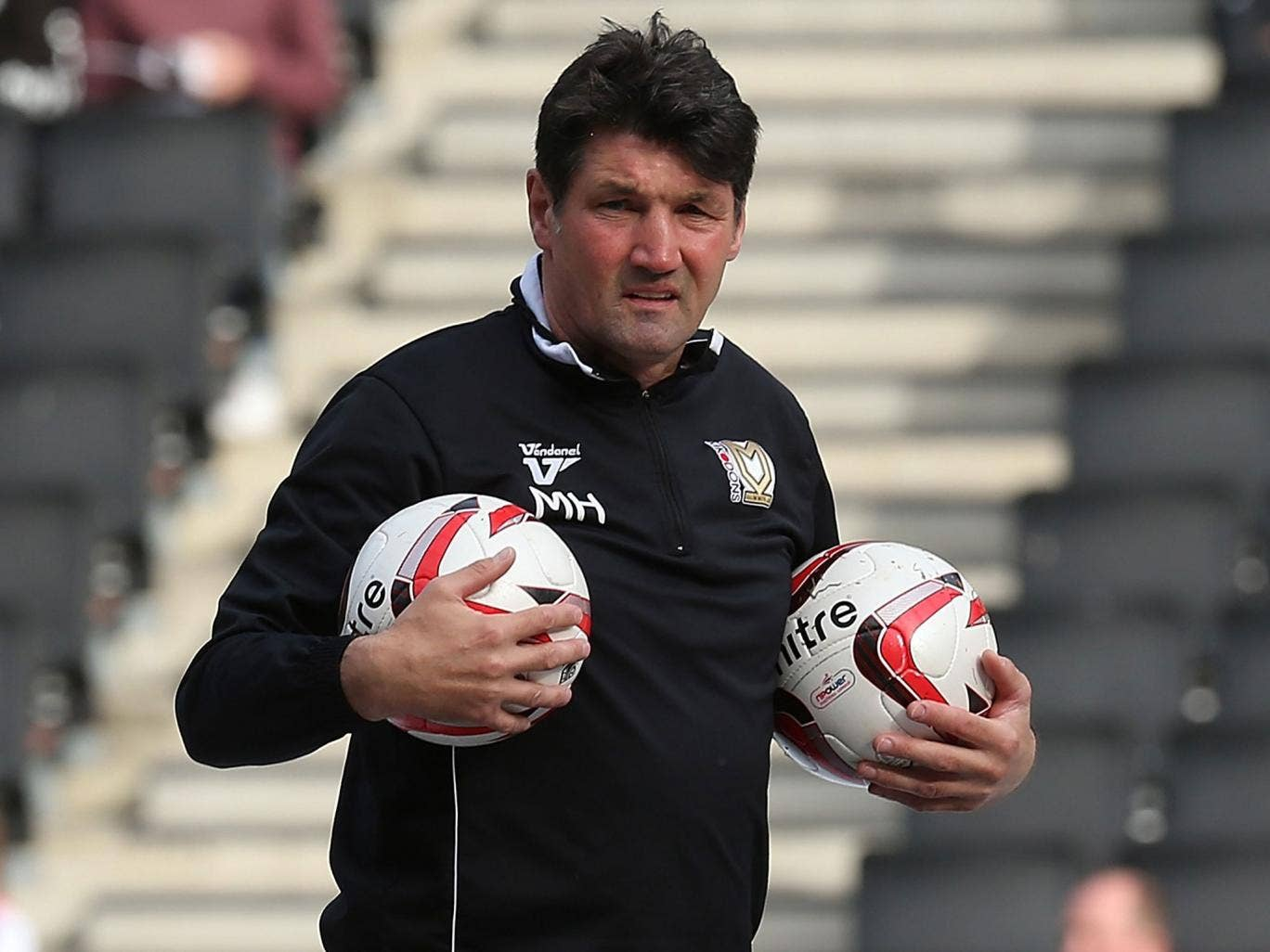 Turf luck: Mick Harford hit an own goal in Luton's last match on plastic