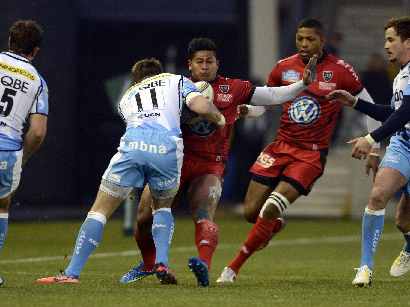 Shark attack: The Sale wing Mark Cueto tackles Toulon's David Smith at the Salford City Stadium