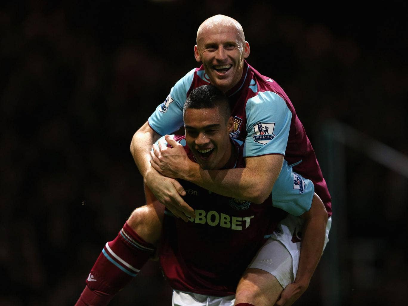 James Collins (top) of West Ham United celebrates the own goal scored by Steven Gerrard of Liverpool with Winston Reid