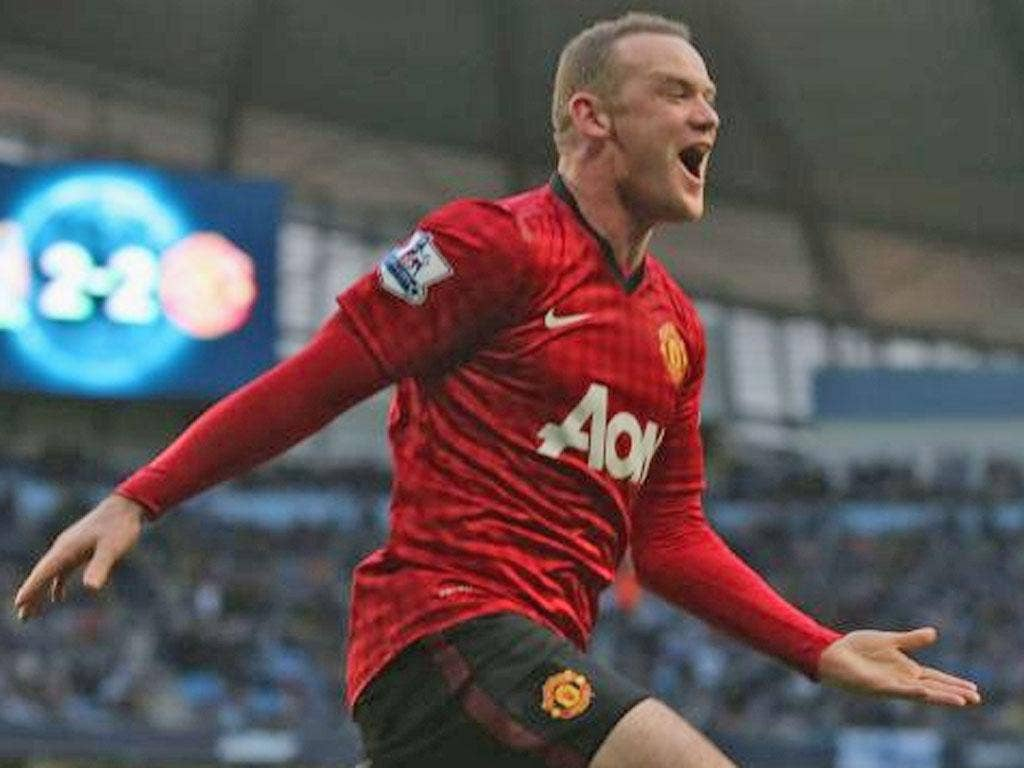 Wayne Rooney of Manchester United celebrates Robin van Persie scoring their third goal