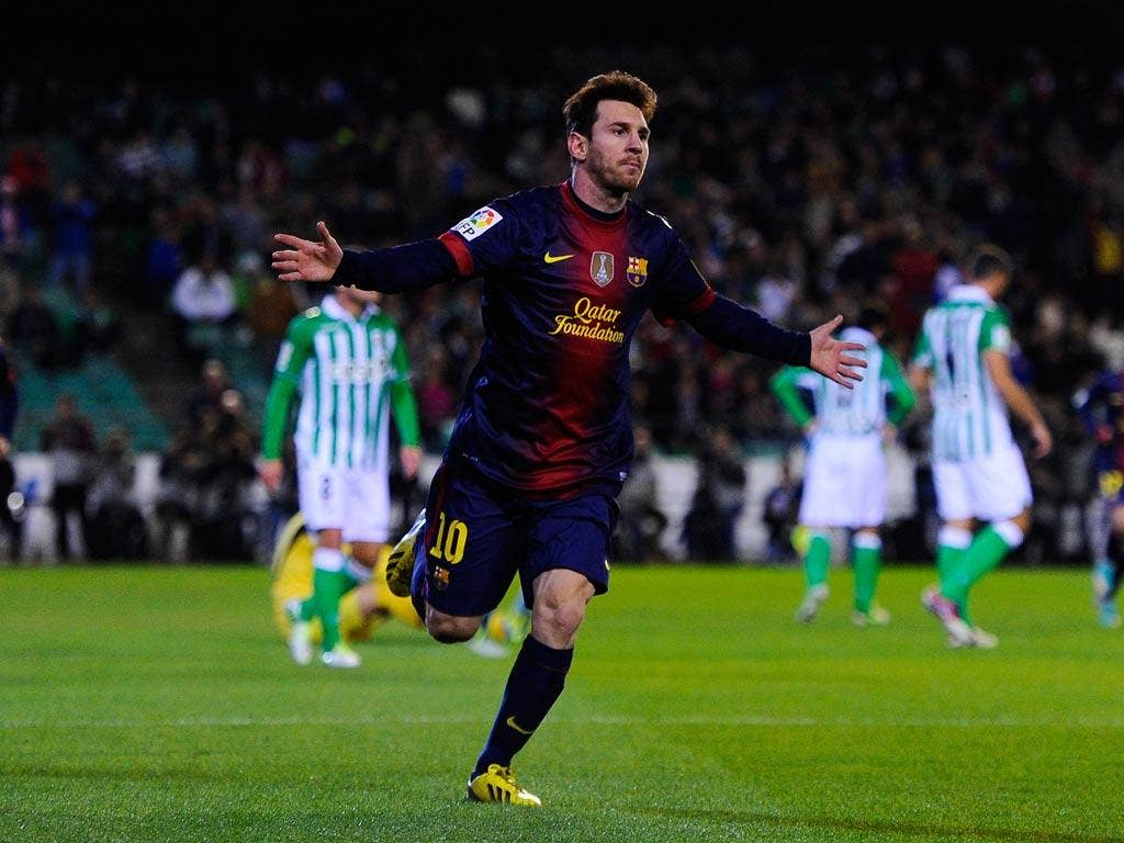 Messi celebrates the goal that took him equal with the record