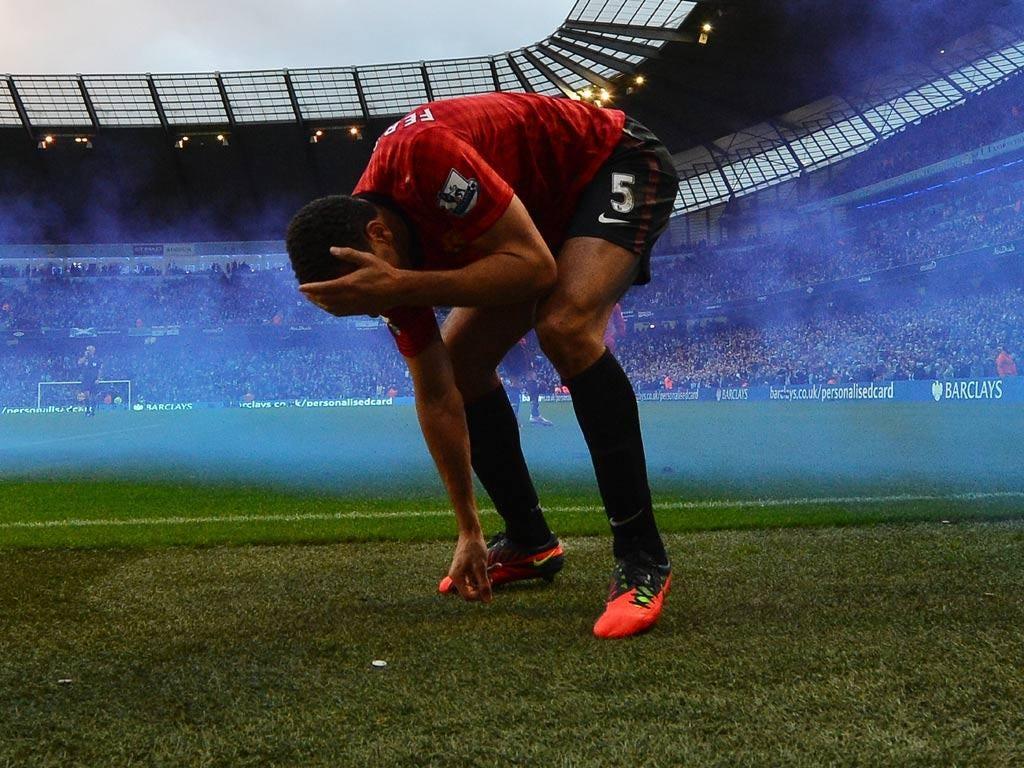 Rio Ferdinand is struck by a coin
