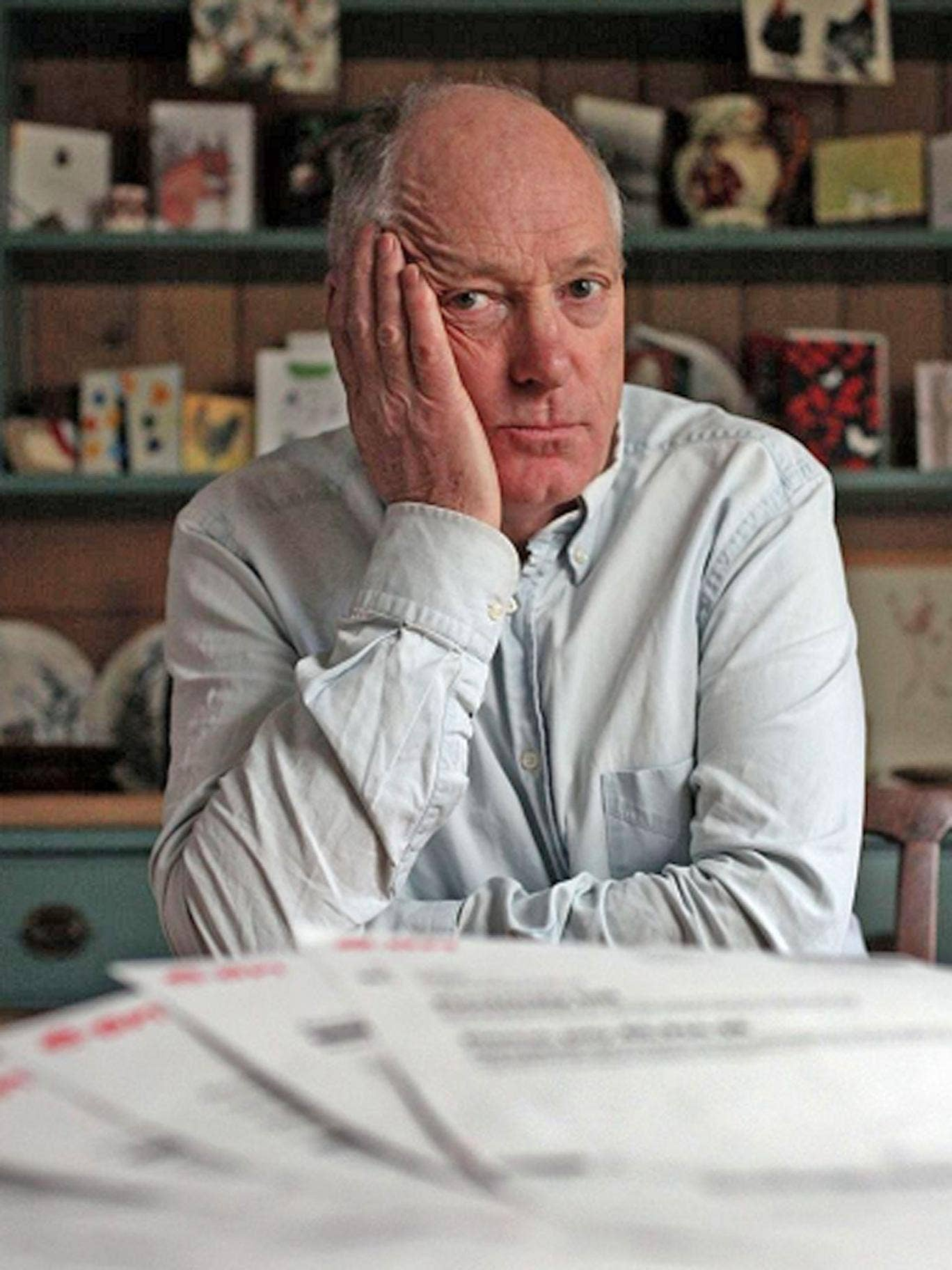 Terence Blacker at home with his baffling 20-page bill