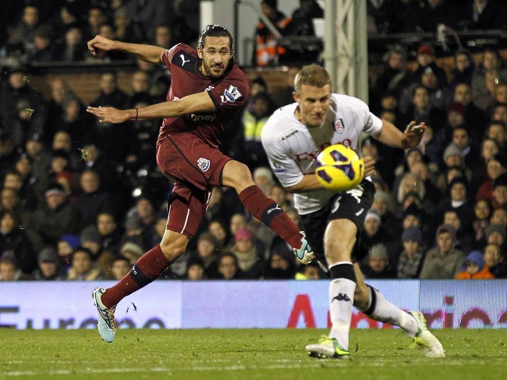 Newcastle United's Jonas Gutierrez has a shot blocked by Fulham defender Brede Hangeland