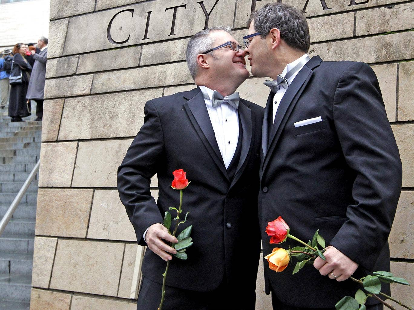 Terry Gilbert, left, and Paul Beppler were among the first gay couples to legally marry in Seattle at the weekend