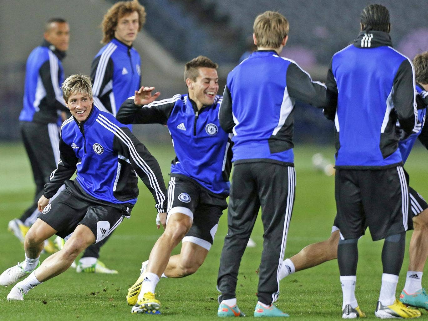 Fernando Torres (left) jokes with his Chelsea team-mates in Yokohama