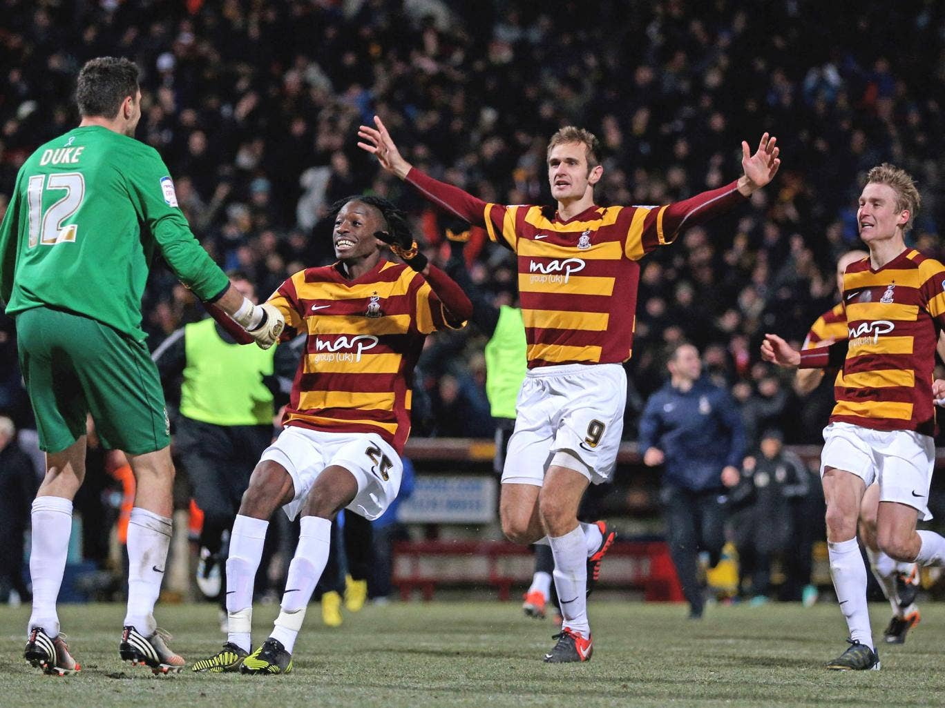 Elated Bradford players celebrate a historic victory