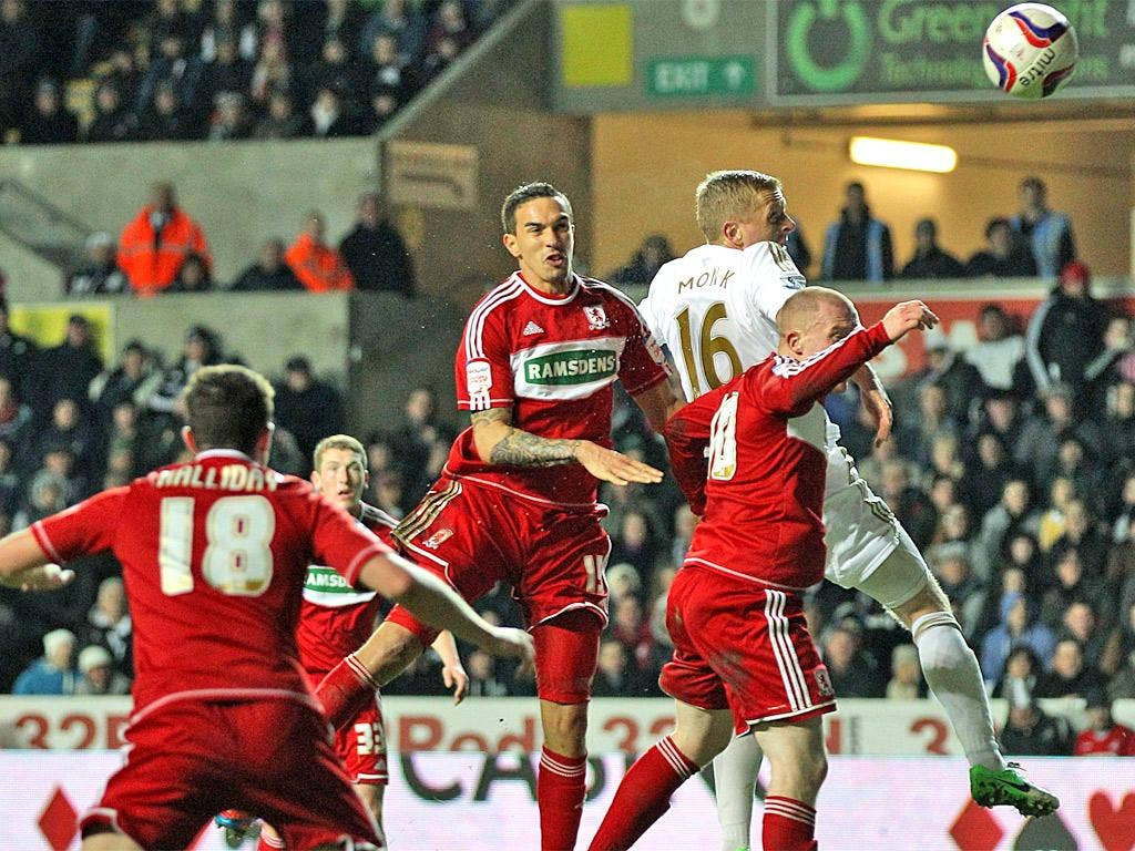 Boro's Seb Hines, centre, scores an own goal while tussling with Gary Monk