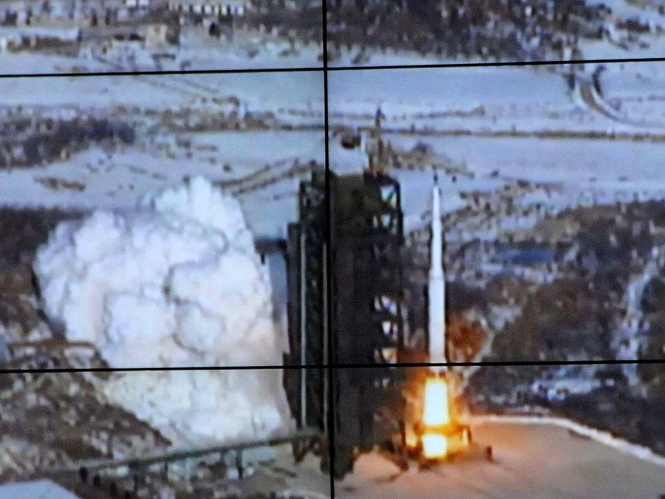 This picture received from North Korea's official Korean Central News Agency  on December 12, 2012 shows the rocket Unha-3, carrying the satellite Kwangmyongsong-3, being monitored on a large screen at a satellite control center in Cholsan county, North P