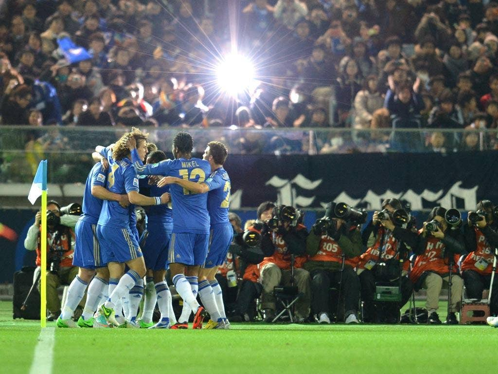 Chelsea celebrate the first goal, scored by Juan Mata