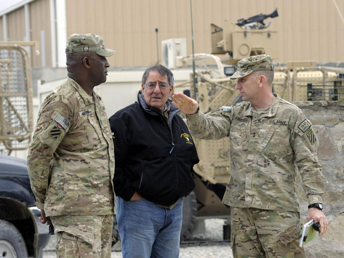 US Defense Secretary Leon Panetta talks with Army Maj. Gen. Robert Abrams, (R) and Command Sgt. Maj. Edd Watson, (L) during a visit to Kandahar Airfield