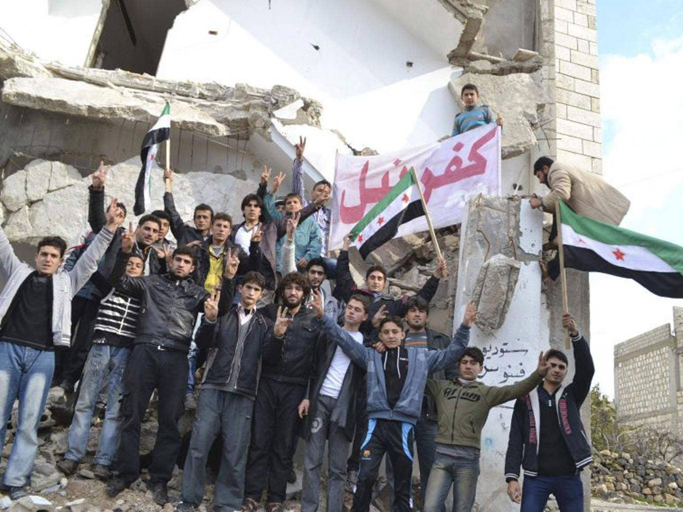 Anti-regime protesters in Idlib province. The rebels appear to be gaining more ground from President Assad's forces R