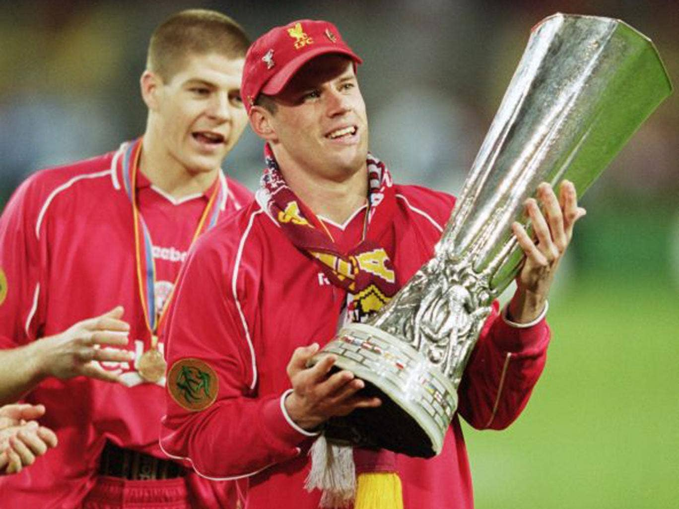 Liverpool's Jamie Carragher, with Steven Gerrard in the background, after winning the Uefa Cup in 2001