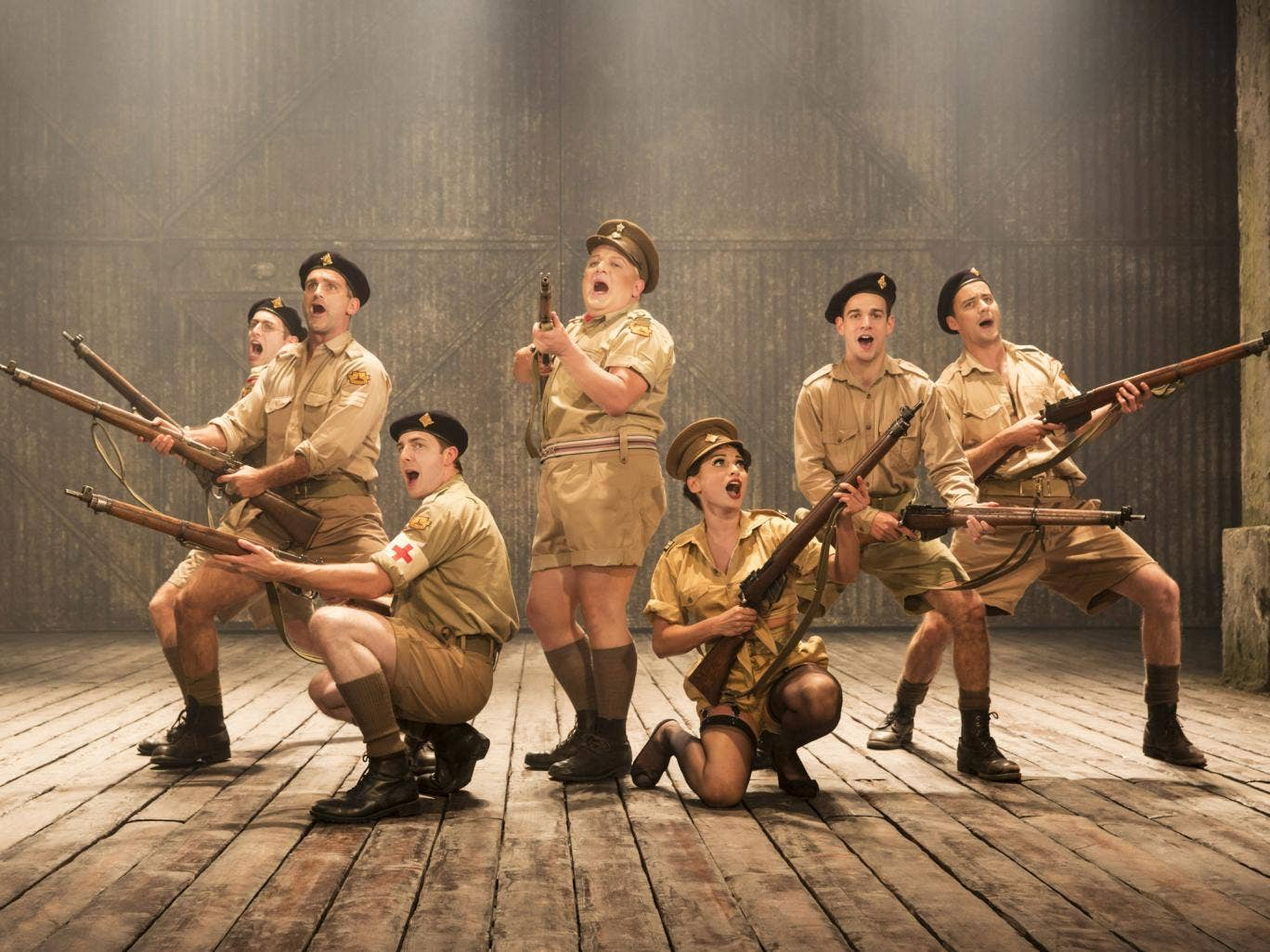 Knees up: Simon Russell Beale, centre, camps it up in Privates on Parade