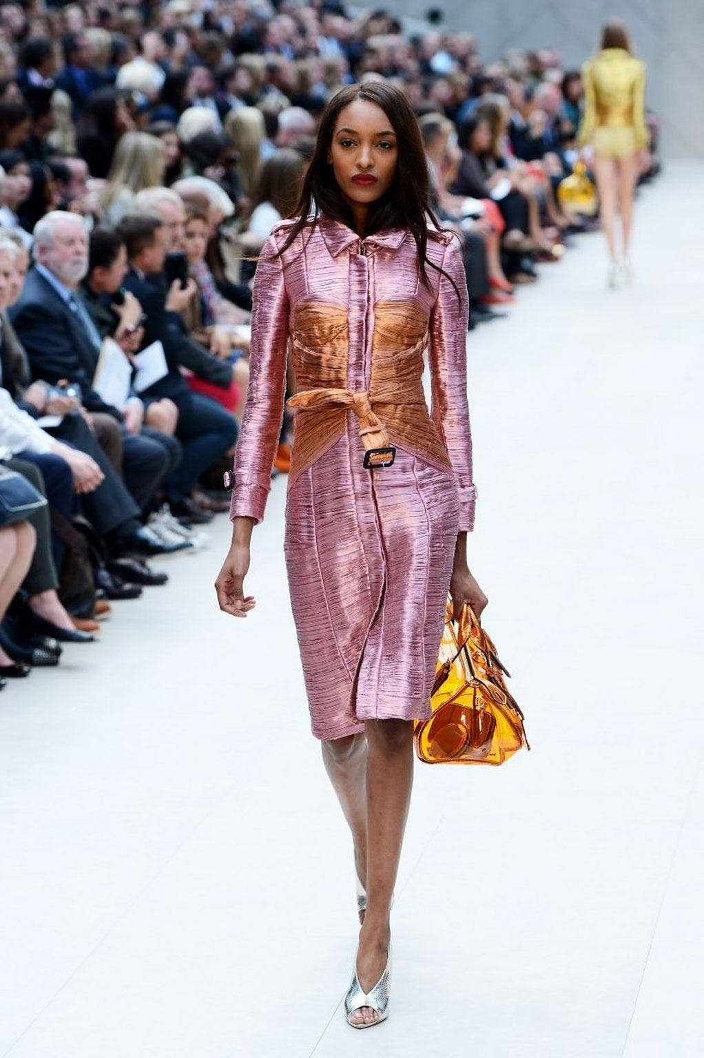 For spring, Burberry's Christopher Bailey dressed models in that fabric, and they shimmered on the catwalk like sweetie wrappers.