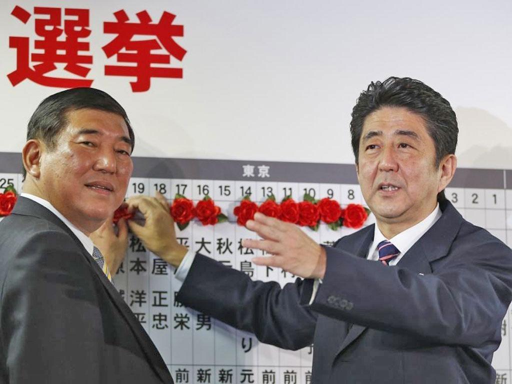 The LDP leader, Shinzo Abe, right, with the party's secretary general Shigeru Ishiba