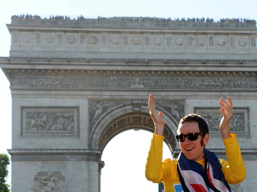 Bradley Wiggins wears the yellow jersey in Paris