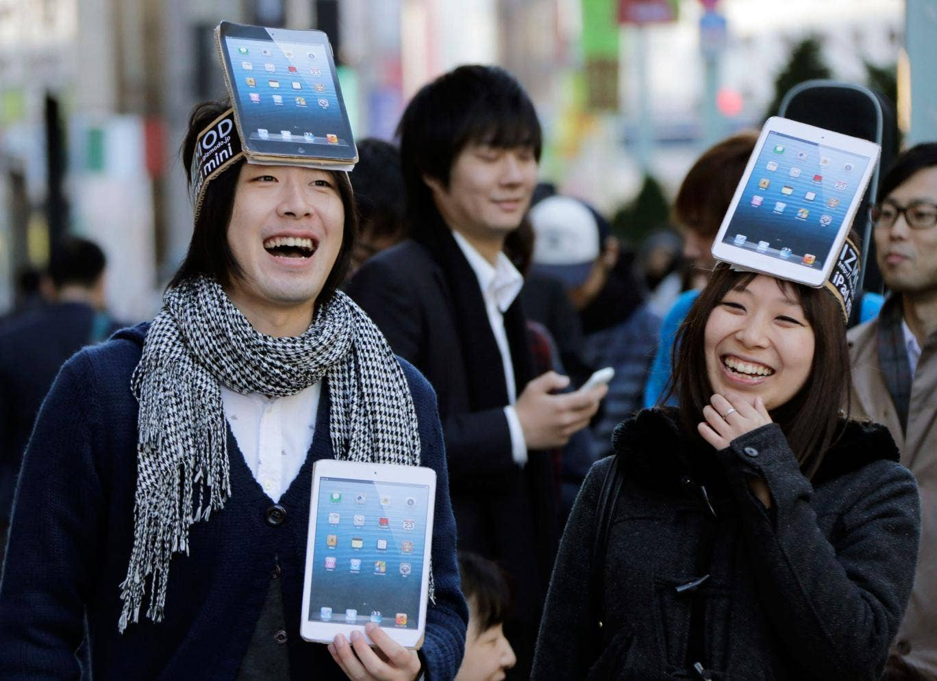 Satisfied Tokyo customers with their new iPad Minis