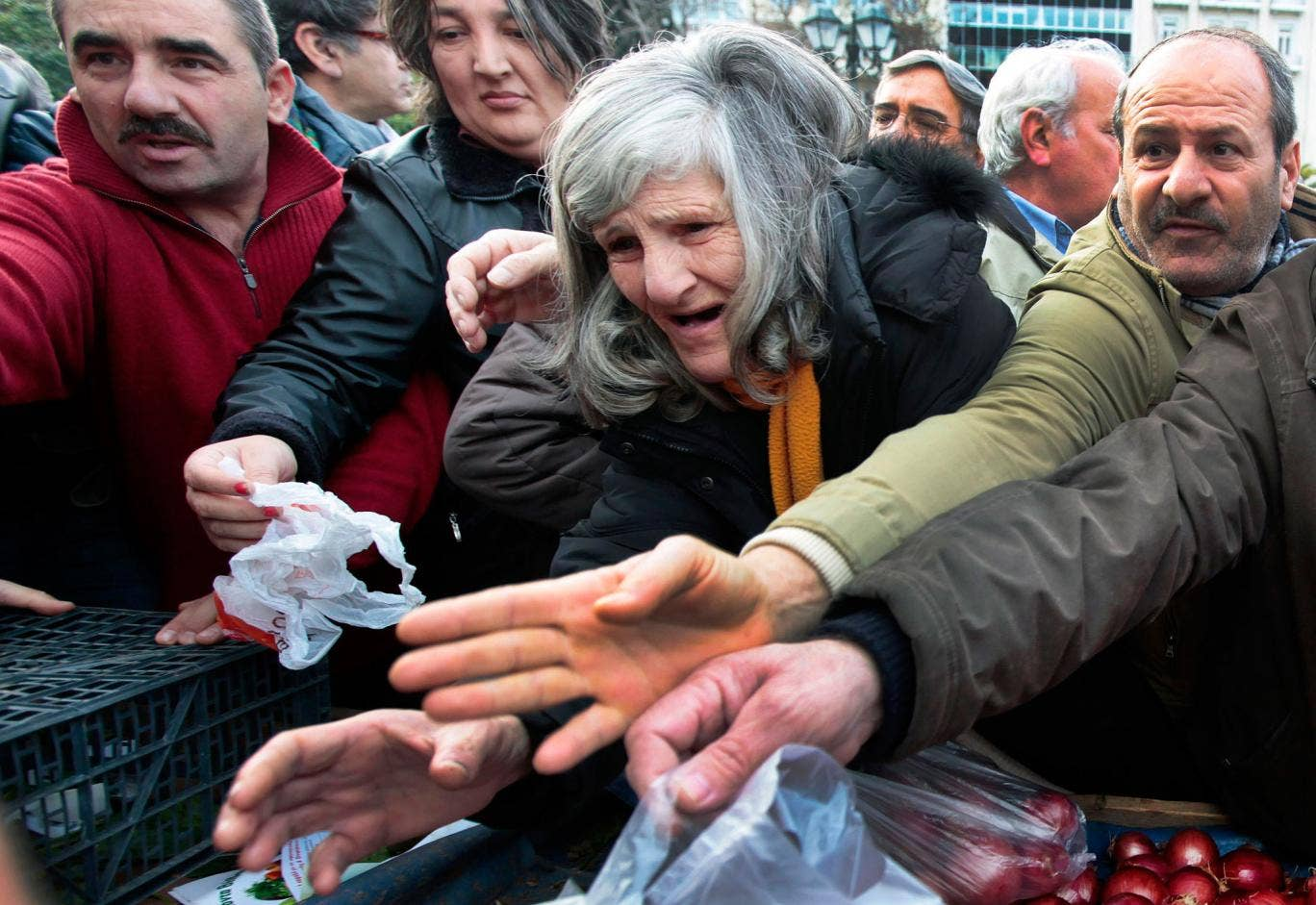 Greeks struggling to get free food in Athens in January 2012