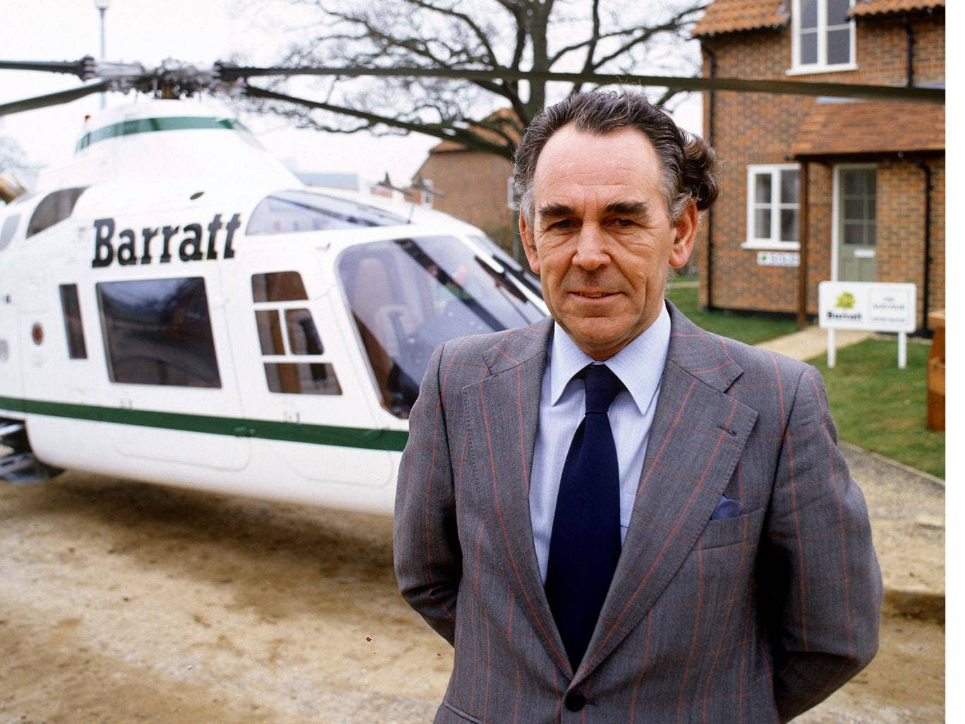 Barratt in 1996 with one of the company helicopters that famously featured in television commercials