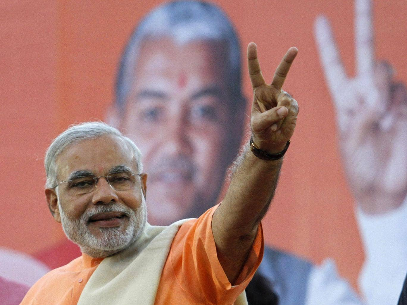 Narendra Modi, chief minister of Gujarat state, gestures on the podium