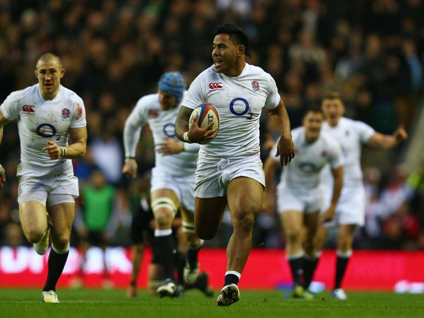 Manu Tuilagi powers towards the line to score against New Zealand
