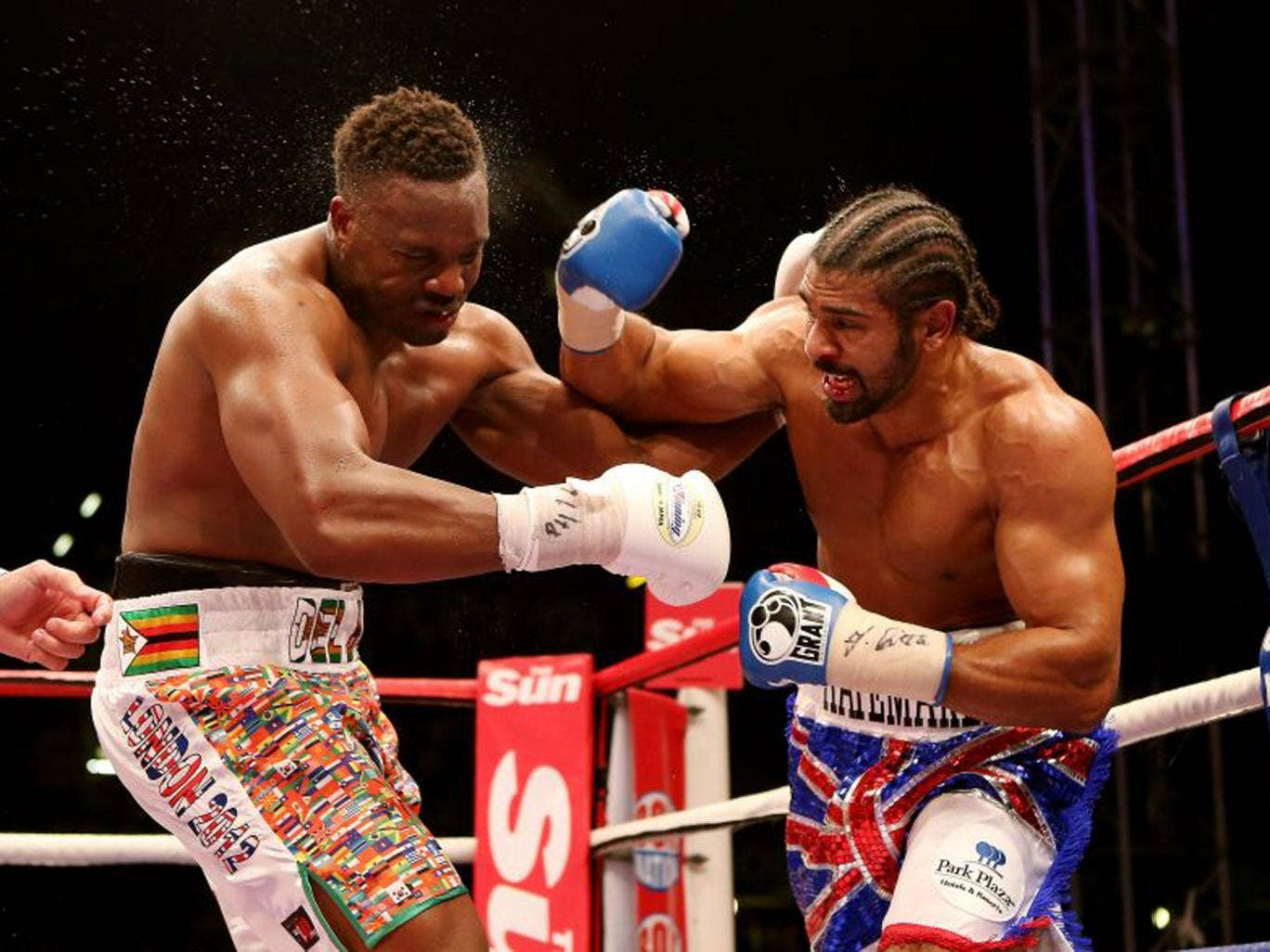 David Haye (right) has Dereck Chisora in trouble at Upton Park