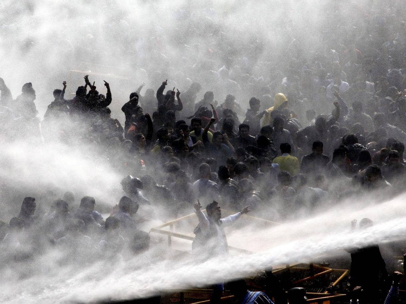 Outrage: Police use water cannon against protesters in Delhi yesterday