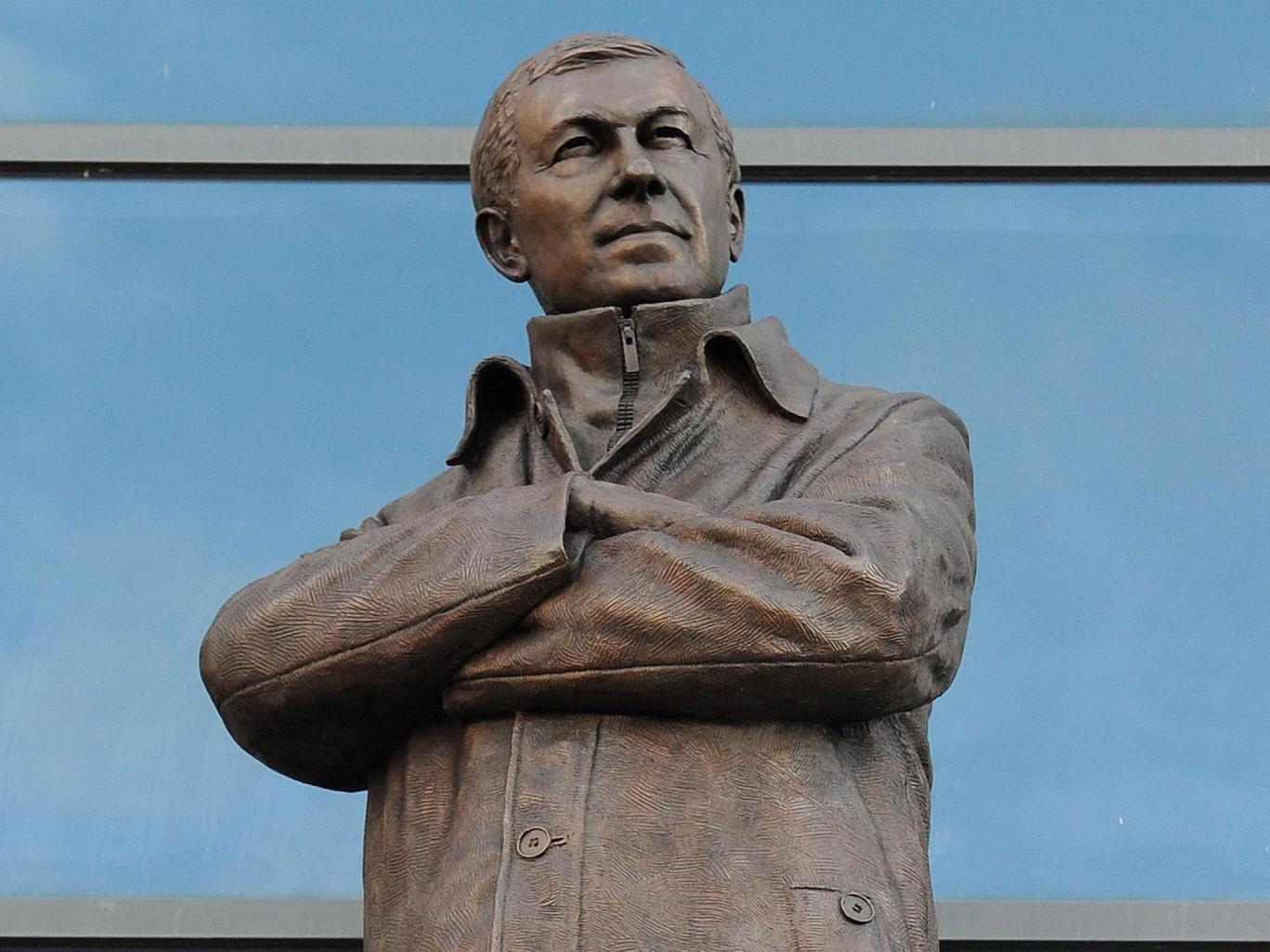 Silence is bronze: A strangely happy-looking statue of Sir Alex Ferguson